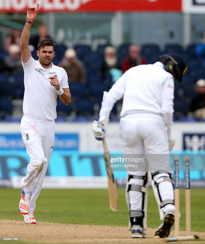 England's James Anderson (L) celebrates bowling out Sri Lanka's Shaminda Eranga (R) for 1 run on the fourth day of the second test cricket match between England and Sri Lanka at the Riverside in Chester-le-Street, north east England, on May 30, 2016. / AFP / SCOTT