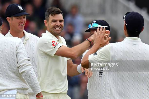 England's James Anderson celebrates taking the catch of South Africa's Chris Morris off his own bowling during the second day of the second Test...