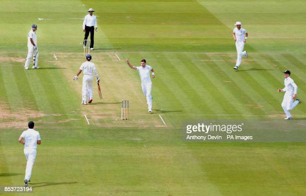 England's James Anderson celebrates taking the wicket of India's Shikhar Dhawan during day one of the second test at Lord's Cricket Ground London