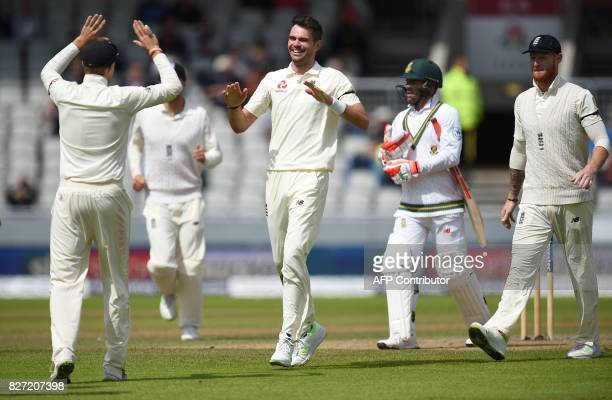 England's James Anderson celebrates taking the wicket of South Africa's Heino Kuhn for 11 runs on day 4 of the fourth Test match between England and...