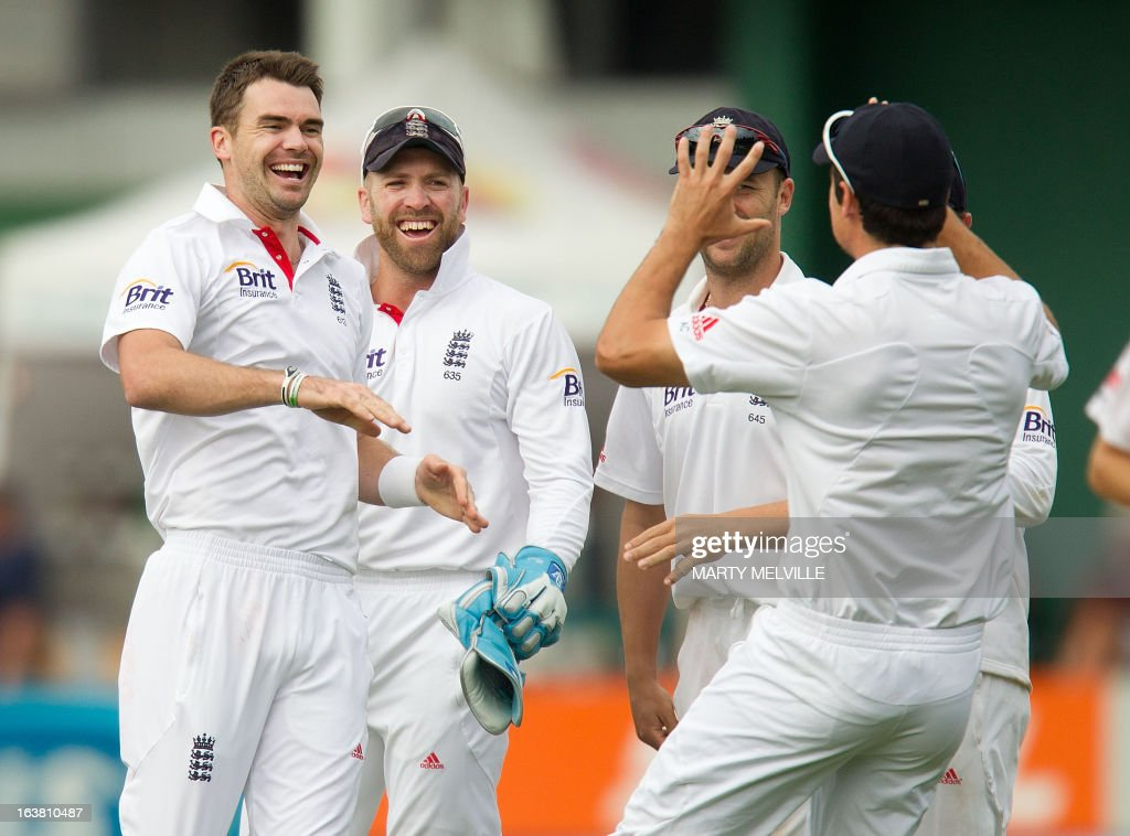 England's James Anderson (L) celebrates with team mates captain Alastair Cook (R Nick Compton and keeper Matt Prior after New Zealand's Peter Fulton was caught out during day four of the international cricket Test match between New Zealand and England played at the Basin Reserve in Wellington on March 17, 2013. AFP PHOTO / Marty MELVILLE
