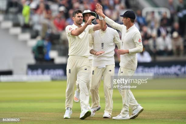England's James Anderson celebrates with teammates after taking the wicket of West Indies' Kyle Hope during the third international Test match...