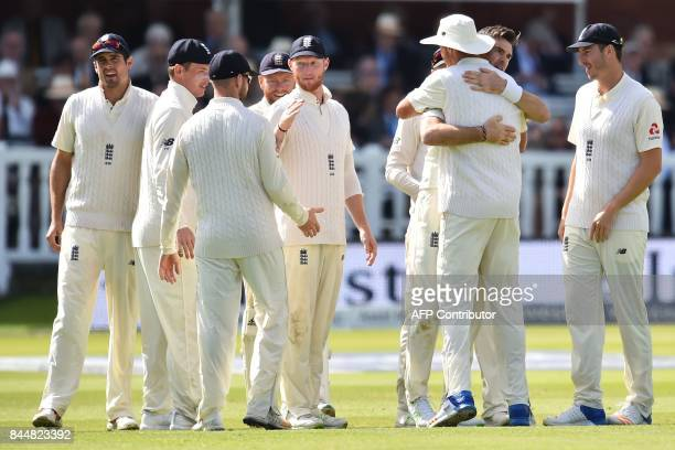 England's James Anderson celebrates with teammates after taking the wicket of West Indies' Shai Hope during the third day of the third international...