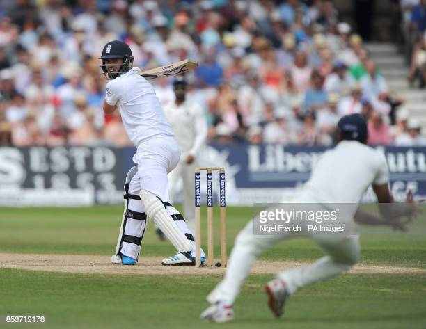 England's James Anderson edges to ball to India's Shikhar Dhawan and is out for 81 during day four of the first Investec test match at Trent Bridge...