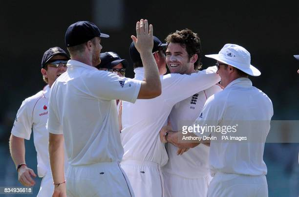 England's James Anderson is congratulated after bowling out India's Virender Sehwag for 9 during the second day of the First Test Match at the M A...