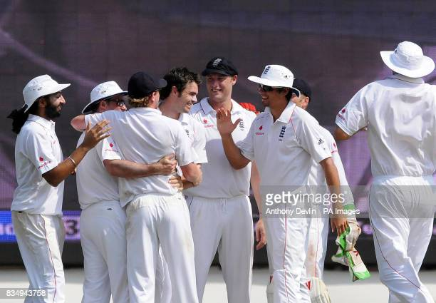 England's James Anderson is congratulated after taking the wicket of Gautam Gambhir for 66 during the fifth day of the First Test Match at the M A...
