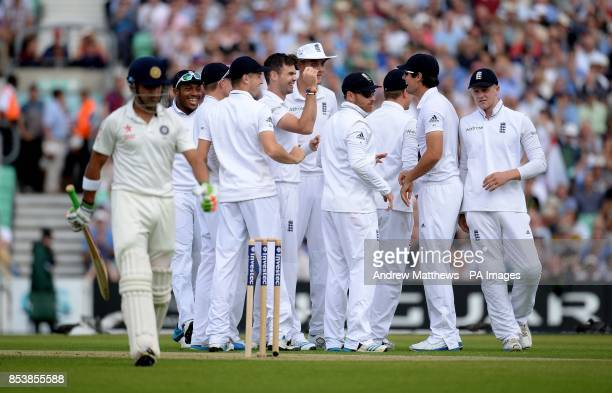 England's James Anderson is congratulated by his team mates after taking the wicket of India's Gautam Gambhir during the Fifth Test at The Kia Oval...