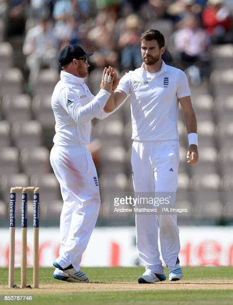 England's James Anderson is congratulated by team mate Ian Bell after taking the last England wicket of India's Mohammed Shami during day four of the...