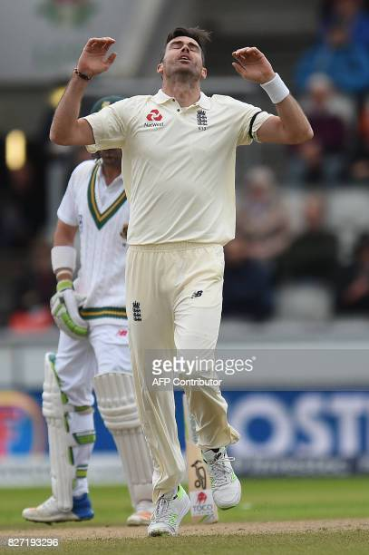 England's James Anderson reacts after South Africa's Heino Kuhn played a shot for four runs on day 4 of the fourth Test match between England and...