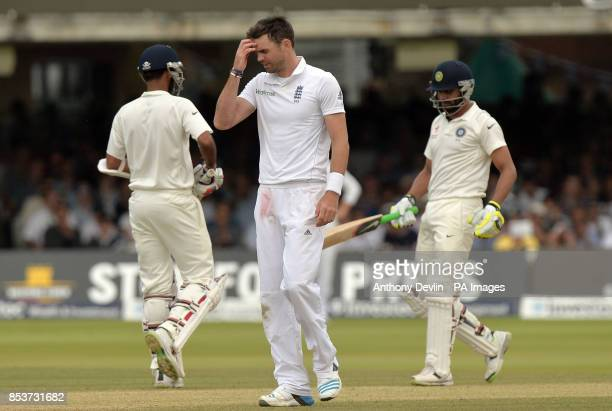 England's James Anderson reacts as India's Bhuvneshwar Kumar and Ravindra Jadeja add runs to the score during day four of the second test at Lord's...