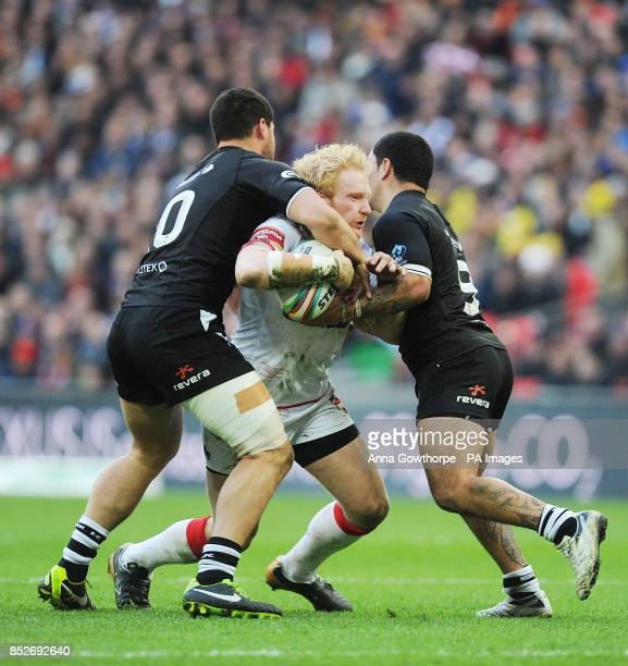 England's James Graham is tackled by New Zealand's Jesse Bromwich and Isaac Luke during the World Cup Semi Final at Wembley Stadium London