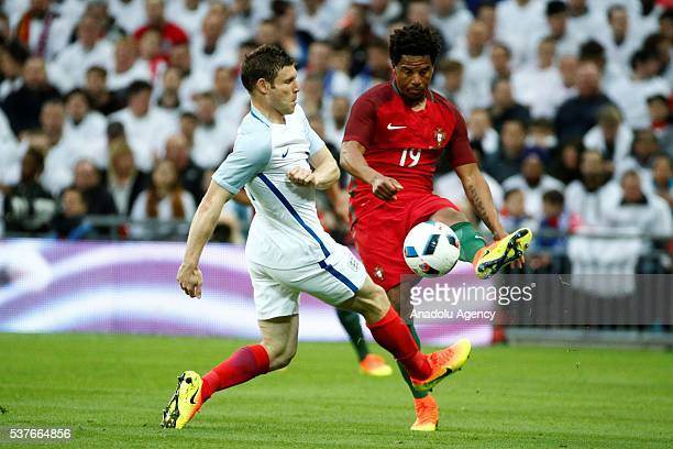 England's James Milner vies with Portugal's Eliseu during an international friendly match between England and Portugal at Wembley Stadium in London...