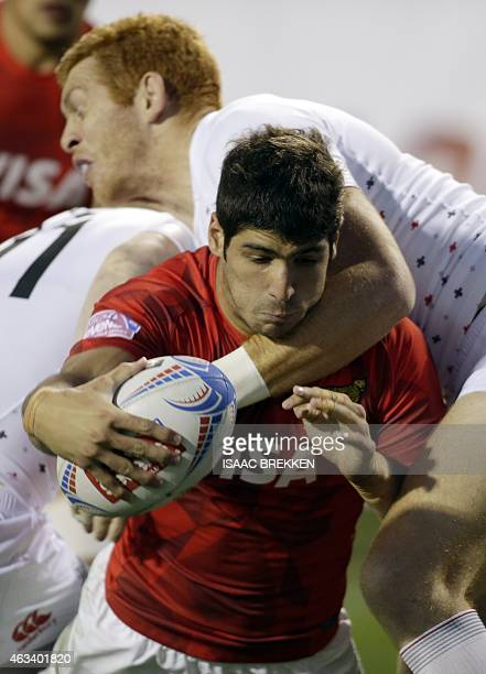 England's James Rodwell tackles Argentina's German Schulz during the USA Rugby Sevens tournament in Las Vegas Nevada February 13 2015 AFP PHOTO /...