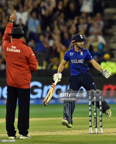 England's James Taylor gestures as umpire Aleem Dar gives him out lbw during the Pool A 2015 Cricket World Cup match between Australia and England at...