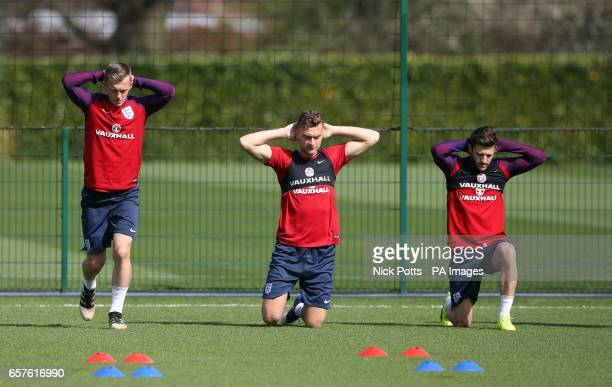 England's James WardProwse Ben Gibson and Adam Lallana during the training session at Enfield Training Ground London