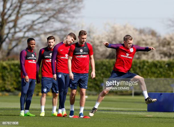 England's James WardProwse jumps between cones during a training session at Tottenham Hotspur's training complex in Enfield north London on March 25...