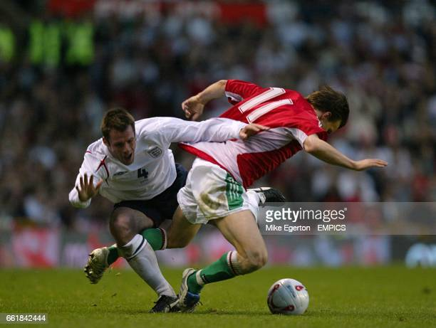 England's Jamie Carragher and Hungary's Sszabolcs Huszti