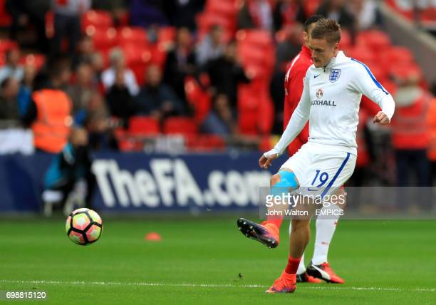 England's Jamie Vardy warms up before the game