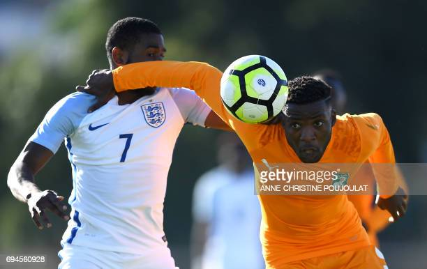 TOPSHOT England's Japhet Tanganga vies with Ivory Coast's Juvenal Agnero during the Under 21 international football final match England vs Ivory...
