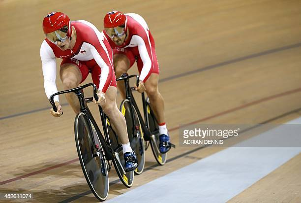 England's Jason Kenny and Kian Emadi compete in the men's team sprint qualifying round in the Sir Chris Hoy Velodrome during the 2014 Commonwealth...