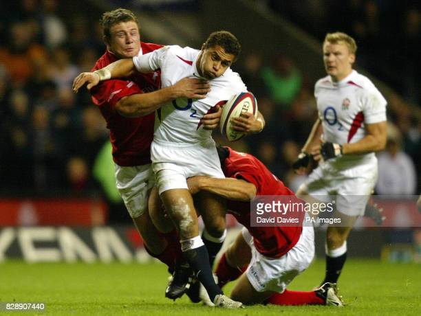 England's Jason Robinson ia tackled by Tony Woodcock and Keith Lowen of the NZ Barbarians during the Zurich World Champions Challenge match at...
