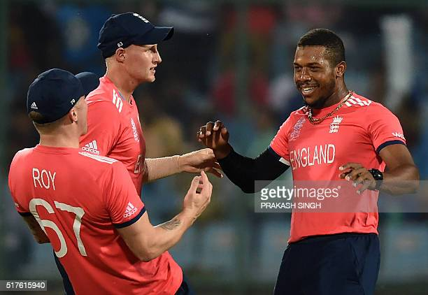 England's Jason Roy Jos Buttler and Chris Jordan celebrate after the dismissal of Sri Lanka's Dinesh Chandimal during the World T20 cricket...