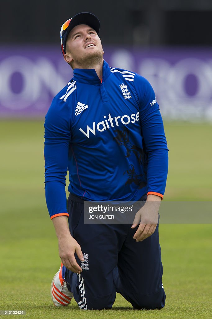 England's Jason Roy reacts after failing to catch Sri Lanka's Dinesh Chandimal off the bowling of England's Chris Woakes during play in the third one day international (ODI) cricket match between England and Sri Lanka at Bristol cricket ground in Bristol, south-west England, on June 26, 2016. / AFP / JON