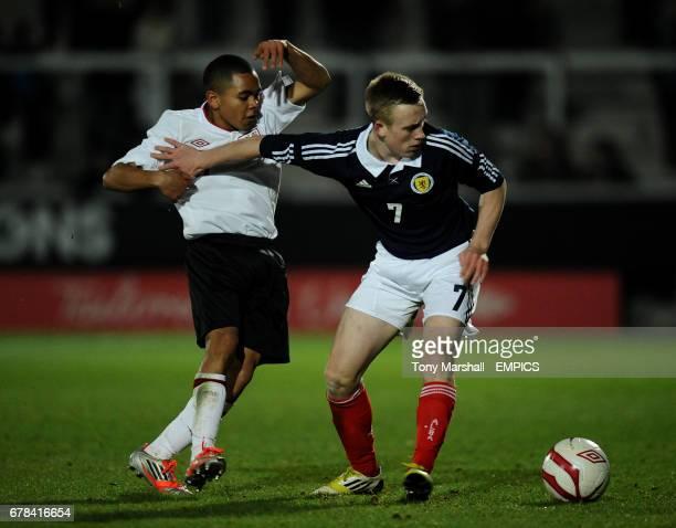England's Jay DaSilva and Scotland's Calvin Miller battle for the ball