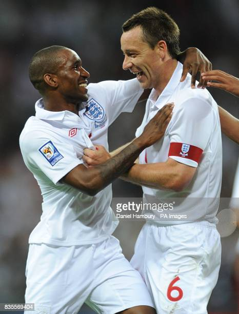 England's Jermain Defoe celebrates scoring their fifth goal with team mate and captain John Terry