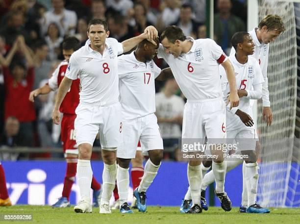 England's Jermain Defoe celebrates with team mates John Terry and Frank Lampard after scoring his sides fourth goal of the game