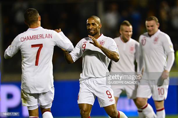 England's Jermain Defoe celebrates with teammate Alex Oxlade Chamberlain after scoring a goal during their World Cup 2014 qualifying football match...