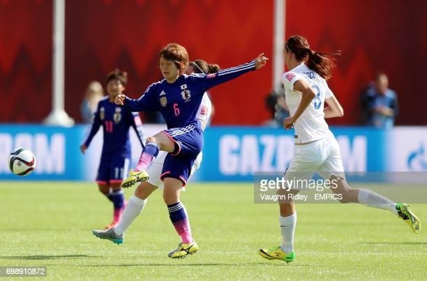 England's Jill Scott puts Japan's Mizuho Sakaguchi under pressure during the FIFA Women's World Cup Canada 2015 Semi Final match between Japan and...