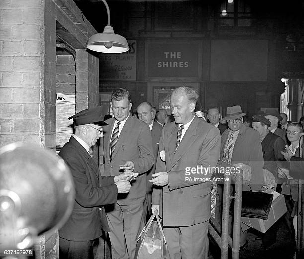 England's Jim Laker and Tony Lock have their tickets checked before boarding a train at St Pancras station on the first leg of the journey to...