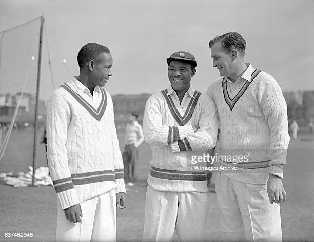 England's Jim Laker chats with West Indies' Roy Gilchrist and Everton Weekes