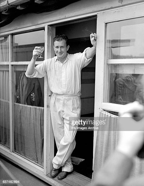 England's Jim Laker toasts victory with a glass of champagne after taking six second innings wickets