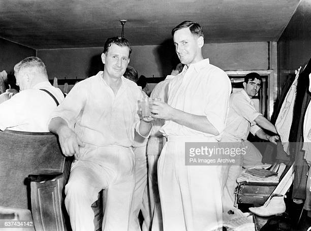 England's Jim Laker who took nine wickets for 37 in the first innings celebrates his performance with captain Peter May