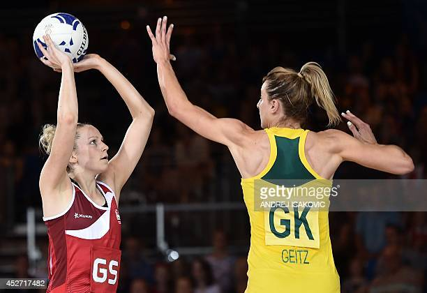 England's Joanne Harten challanges Australia's Laura Geitz during a Netball Group B Preliminary Round match between Australia and England at the 2014...