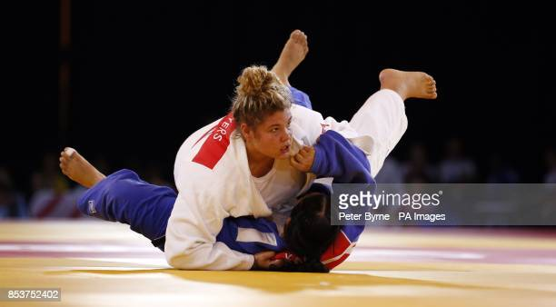 England's Jodie Myers and India's Rajwinder Kaur compete in the women's 78 Kg at the SECC during the 2014 Commonwealth Games in Glasgow