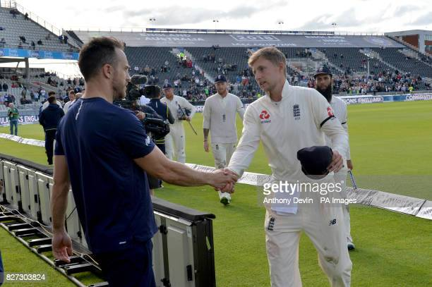England's Joe Roopt shakes hands with the South Africa captain Faf du Plessis during day four of the Fourth Investec Test at Emirates Old Trafford...