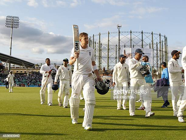 Englands Joe Root acknowledges the crowd as he leaves the field at the end of the second day of the fifth cricket Test match between England and...