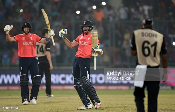 TOPSHOT England's Joe Root and Jos Buttler celebrate after winning the World T20 cricket tournament semifinal match between England and New Zealand...