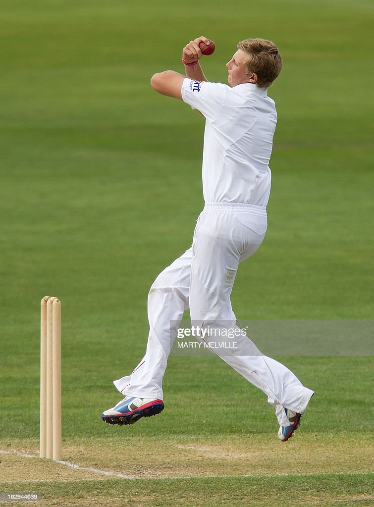 England's Joe Root bowls on the last day of the four day warm-up international cricket match between New Zealand XI and England in Queenstown on March 2, 2013. AFP PHOTO / Marty MELVILLE