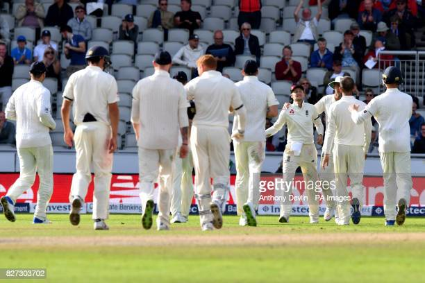 England's Joe Root celebrates catching South Africa's Morne Morkel during day four of the Fourth Investec Test at Emirates Old Trafford Manchester