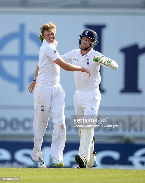 England's Joe Root celebrates with team mate Jos Buttler after taking the wicket of India's Shikhar Dhawan during day four of the Third Investec Test...