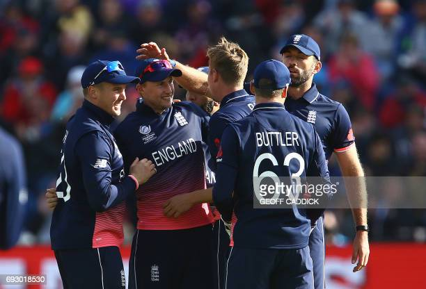 England's Joe Root celebrates with teammates after catching New Zealand's Ross Taylor for 39 during the ICC Champions Trophy match between England...