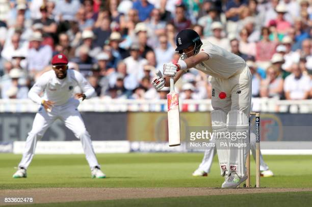 England's Joe Root gets hit by the bowling of West Indies' Kemar Roach during day one of the First Investec Test match at Edgbaston Birmingham