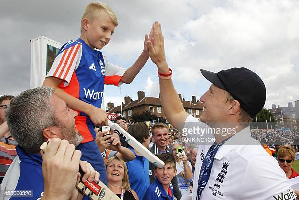 England's Joe Root highfives a young supporter as England celebrate their series victory after the fourth day of the fifth Ashes cricket test match...