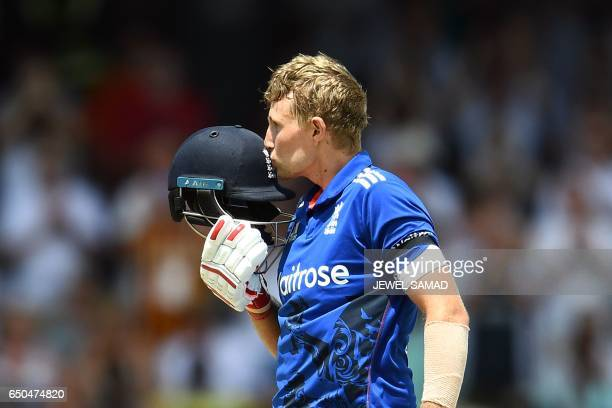 England's Joe Root kisses his helmet to celebrate after scoring his century during the final of the threematch One Day International series between...