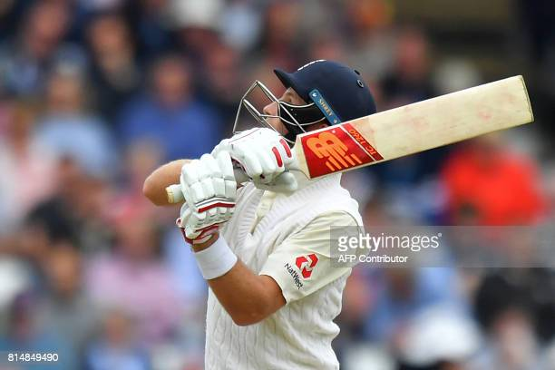 England's Joe Root watches his shot during play on the second day of the second Test match between England and South Africa at Trent Bridge cricket...