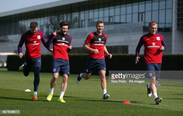 England's John Stones Adam Lallana Ben Gibson and James WardProwse during the training session at Enfield Training Ground London